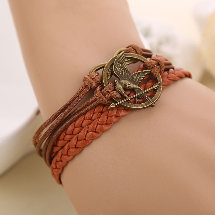 2016 New Europe The Hunger Games Jewelry Bracelets 8 birdies four strands braided leather cord bracelet wholesale Free shipping