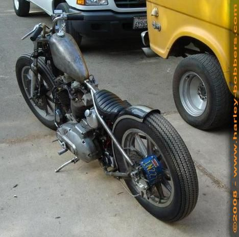 1977 Harley Ironhead skinny hardtail custom with mid-controls, bare metal tank and short bars