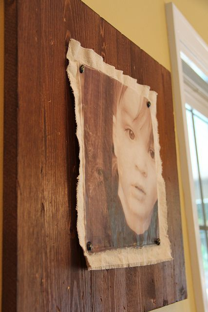 Print out a photo in sepia tone on velum, dip in wax, and pin it onto a piece of canvas or burlap onto an old board.  Beautiful and unique DIY for your favorite photos.
