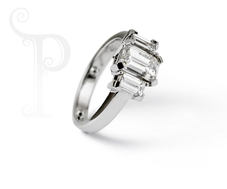 Handmade Platinum Trilogy Ring, Set With a Emerald Cut Diamond And two Baguette cut diamonds