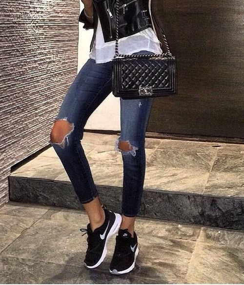 Street style, casual outfit, spring chic, summer chic, black biker jacket, white tee, ripped jeans, black Nike sneakers, black Chanel Boy bag