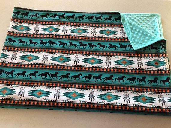 Cuddly soft teal dimple minky paired with teal Navajo horse print cotton adult Throw blanket. The super soft effects of minky will have you loving this blanket to cuddle up for nap time and couch time. Your kids may even feel a bit jealous of you and want to cuddle the blanket