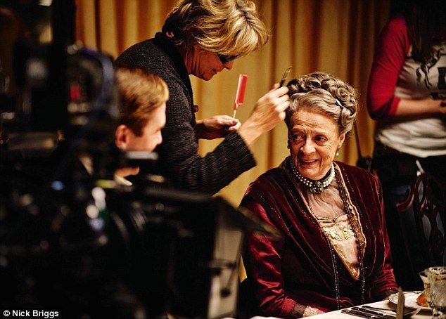 Dame Maggie Smith's elaborate hairdo gets a tweak for a dinner table scene