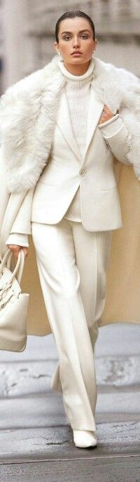 what an awesome white on white outfit for F/W. White suit with white turtleneck top, coat with fur lapels and bag