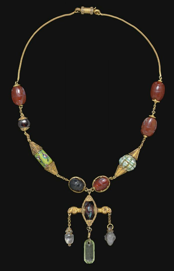 A NECKLACE OF ETRUSCAN SCARABS   CIRCA 5TH CENTURY B.C.   All mounted in a Victorian gold necklace, in the a globolo style.