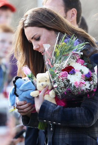 Will and Kate Get Sporty During Their Royal Visit to Glasgow: Kate Middleton waved at her fans. : Kate Middleton and Prince William arrived in Glasgow. : Fans showered Kate Middleton with gifts and flowers.