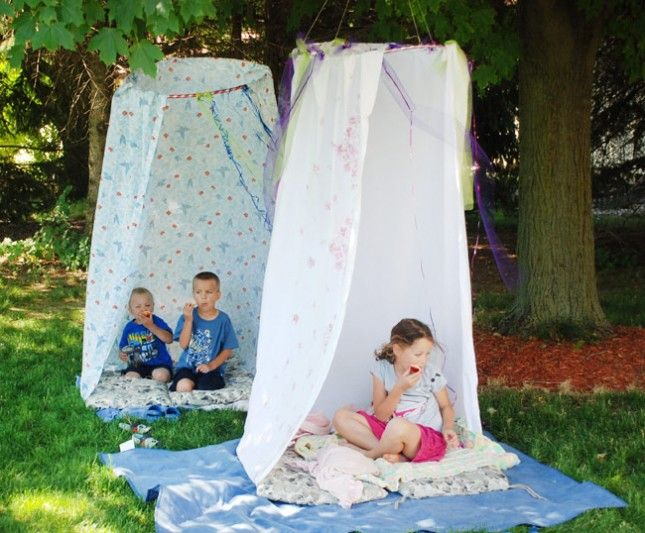 Create a clubhouse for the kiddos using a hula hoop and a bed sheet.