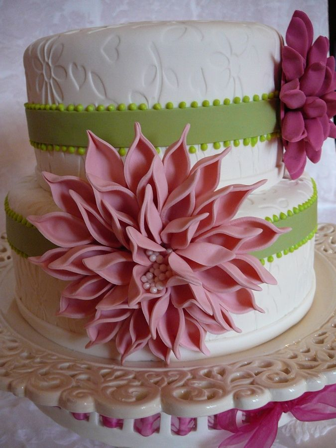 A classic two tier embossed cake with dahlia flowers. This is a spice cake with buttercream all covered with fondant. I love the effect of these flowers!