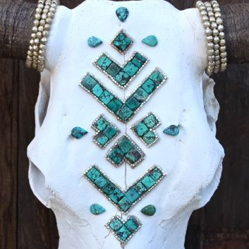 >> Bleached Cow Skull  >> Real Turquoise stones are cut and laid in a Navajo pattern >> Layered Ethiopian Heishi beads surround arrow.  >> Ethiopian Heishi detail around the horns