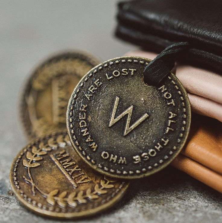 Our signature coin by Wanderers Travel Co. Photo by @scottsurplicephotography