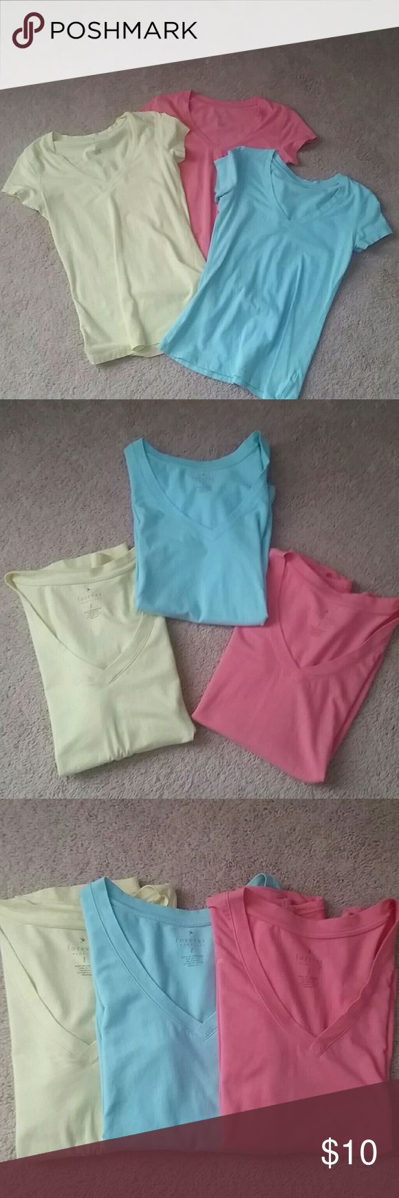 3 Forever 21 shirts Blue, yellow and pink Forever 21 basic tshirts. V-neck Short sleeve Large 95% cotton, 5%spandex Forever 21 Tops