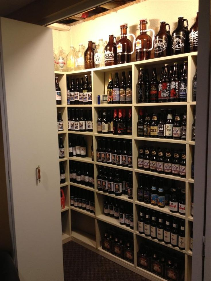 Decorating Furniture Interior. Good Looking Diy Wine Cellar Decoration Ideas. Interesting Diy Wine Cellar Decoration Featuring Cream Stained Wooden Wine Cellar And Big Glass Wine Bottle In Brown And Glass Wine Bottle Together With Clear Glass Wine Bottle And Also Gray Floor Tile And White Door With Iron Handle Classic. Diy Wine Cellar