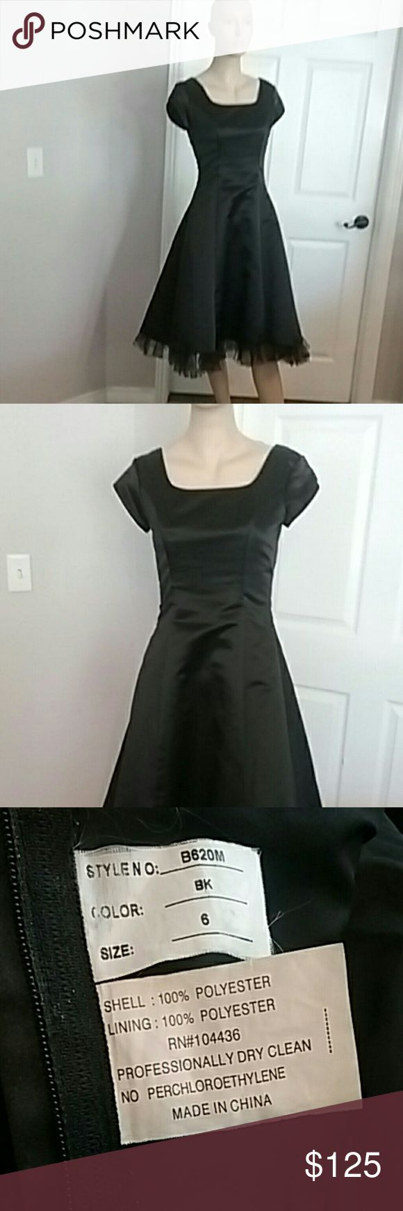 Size 6 Black tea length homecoming dress Modest  size 6 black tea length homecoming, prom, or special occasion dress. Zipper back. Short cap sleeve. Excellent condition. Dresses Prom