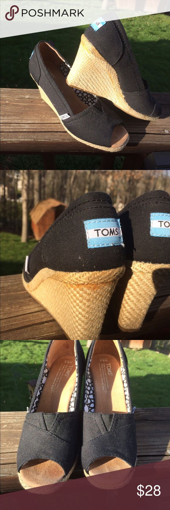 Toms black wedges size 6.5 Worn 3-4 times-have been in storage for over 1 year. Black wedges with jute trim. Toe mark is very faint. Some glue ? Visible just under trim on heel of left shoe-see picture. Closet clean out! Very gently worn. TOMS Shoes Wedges