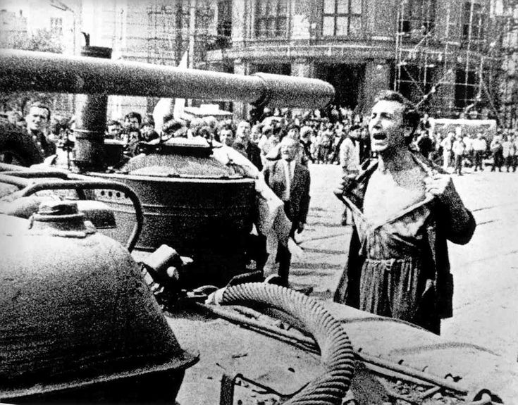 Czechoslovakia. Prague Spring // photo by Ladislav Bielik. Soviet invasion of the Czechoslovak Socialist Republic (Czechoslovakia), 20/21 August 1968 (passive resistance by the Slovak people). - A man bares his chest in front of a tank belonging to the invading Warsaw Pact troops. - Photo, Bratislava, 21 August 1968.