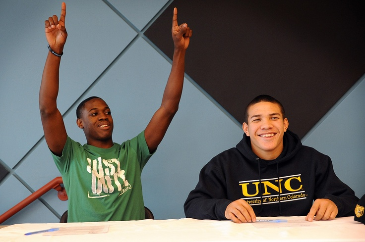 Twelfth graders Aaron Johnson, 17, and Brandon Cartagena, 17, sign letters of intent for athletic scholarships Feb. 6 at Vista Ridge High School in Falcon School District 49. Johnson will play football for Eastern New Mexico University in Portales, N.M. Cartagena will play for University of Northern Colorado in Greeley. Johnson says he made a pact with Cartagena while attending Skyview Middle School: they'd both play professional football.