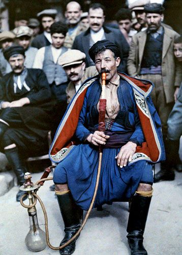 A man in national costume smokes a waterpipe, Crete