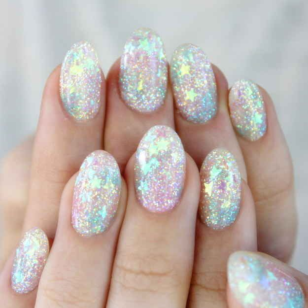 This perfect display of glitter glam. For this set the artist used pastel pink, blue, and yellow glitter. In addition, she also used little bits of white holographic glitter from young nails. The stars are super thin and sheer, but they looked white in the package.  All the glitter is inlayed in the hard gel overlay, so they look all floaty and magical! Inlay process: put down clear first and sprinkly in some glitter before curing. The glitters are sandwiched between layers of hard gel :)