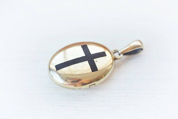 This is a rare antique Victorian gilded solid sterling silver photo locket with niello or enamel black cross. The pendant is solid silver, has nice gilding. The gilding is a bit worn on the back of the pendant. If you open it there are two old sepia photos, but you can put your own. On