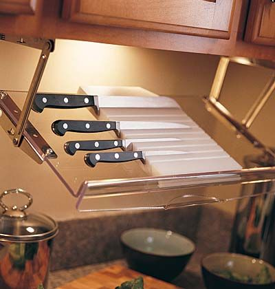 This type of rack pulls down from the upper cabinet, a location that keeps knives where they are handy for a cook but beyond the reach of young children. -Awesome idea!