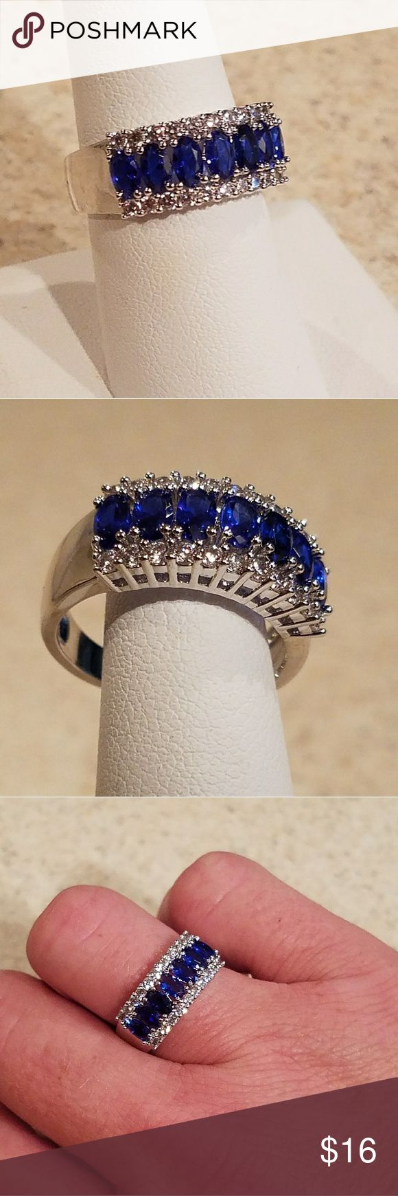 New WGP Oval-Cut Lab Created-Blue CZ Ring Size 8 New & Stunning! Gorgeous White Gold Plated 7 Stone Oval-Cut Lab Created-Blue Cubic Zirconia Ring!!! Tons of Sparkle & Shine! Add a pop of color to spice up any Look! Size 8  PLEASE USE OFFER FEATURE TO NEGOTIATE. THANKS! Jewelry