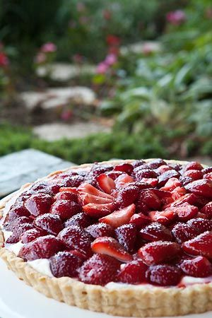 Tart with fresh strawberries, macerated in sugar, over a creamy mascarpone base and brushed with a balsamic glaze.