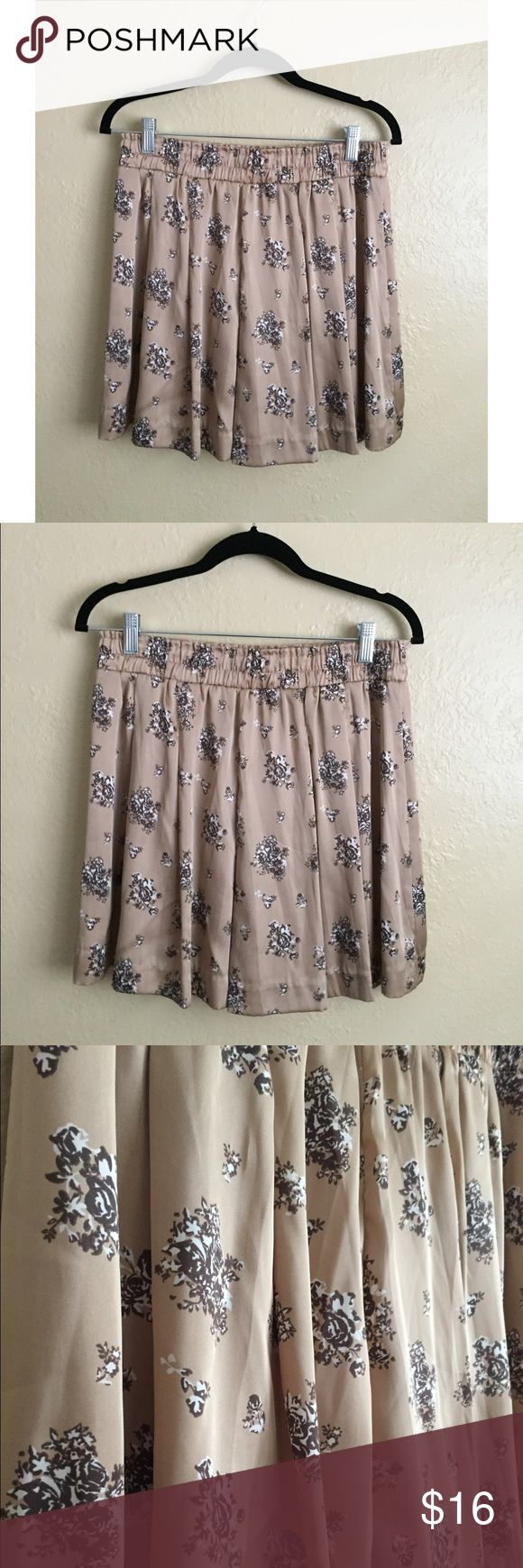 """NWOT Satin Floral Shorts 🌸 NWOT and never worn. UNIQLO shorts in a taupe satin and all over floral print. Length is 17"""" from waist to hem. Fit is high waisted with oversized elastic. True to size. For all other measurements please refer to brand size chart.   ✅ Reasonable offers considered. Please do not ask 'lowest' via comments  ✅ Bundle Discount  🚫 Cannot model item  🚫 No trades  🚫 Low ball offers will be declined Uniqlo Shorts"""