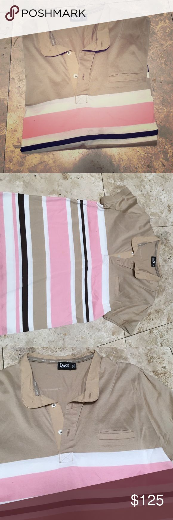Men's D&G Polo Authentic D&G. In good condition. One small stain on the large pink strip on mid stomach (pictured). Hard to see if you aren't looking for it. Small size tag from inside near side of stomach was cut out because it itched. D&G Shirts Polos