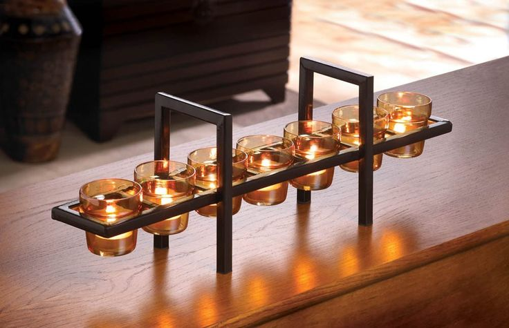 """Contemporary modern """"Sunset Bridge"""", multiple candle stand with amber glass cups. This contemporary candle holder centerpiece will look great on any table as an accent in your home."""