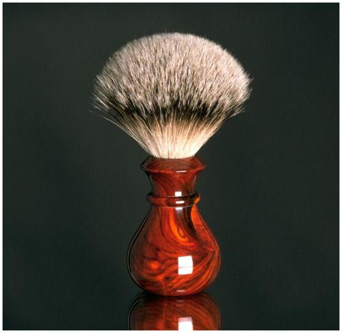 Shaving brush - a good shaving brush gives gentle & good clean to old books.