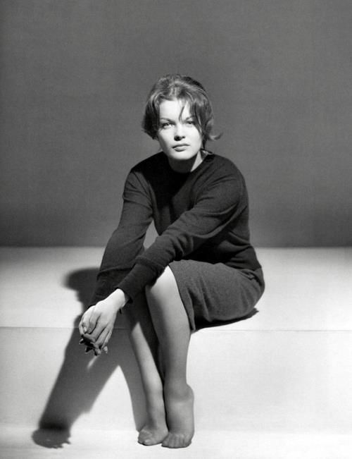 On her toes, legs together in her stockings, dressed in black anthracite, hands put forward, slightly aside, and in the middle of all of that, the look, frank and decided. Romy Schneider.