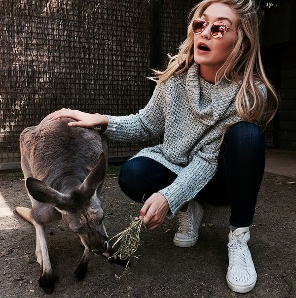 Model #gigihadid wearing #freepeople #dylan sweater found at @envyclothingco