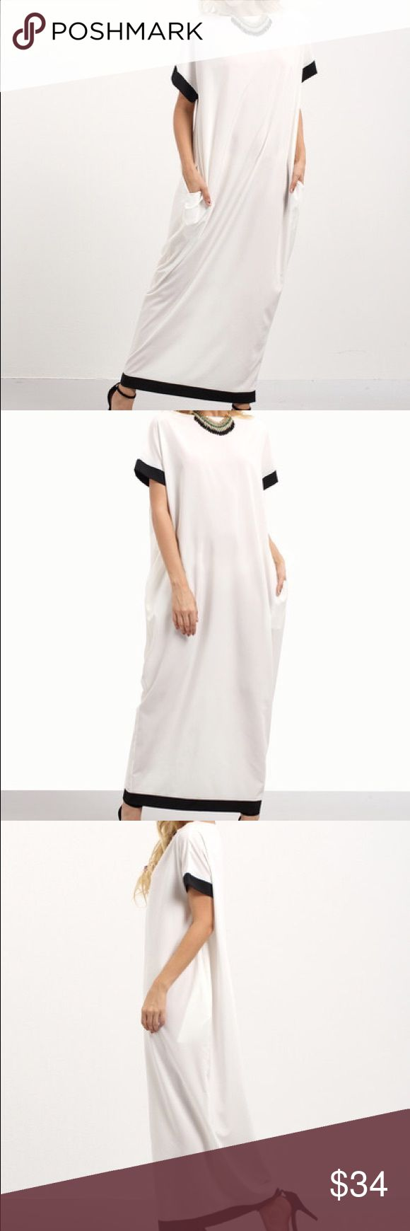 """Light and flowy contrast maxi White with Black Hem and Arm Trim Contrast Shift Maxi Dress                                                                                     This beauty is light and perfect for the season! It has pockets and Fabric has no stretch but is super flowy! Material : 100% Polyester Bust: S:47"""" M:51"""" L:55"""" Length: S:56"""" M:57"""" L:58"""" Sleeve Length: S:10.5"""" M:11.5"""" L:12.5"""" Dresses Maxi"""