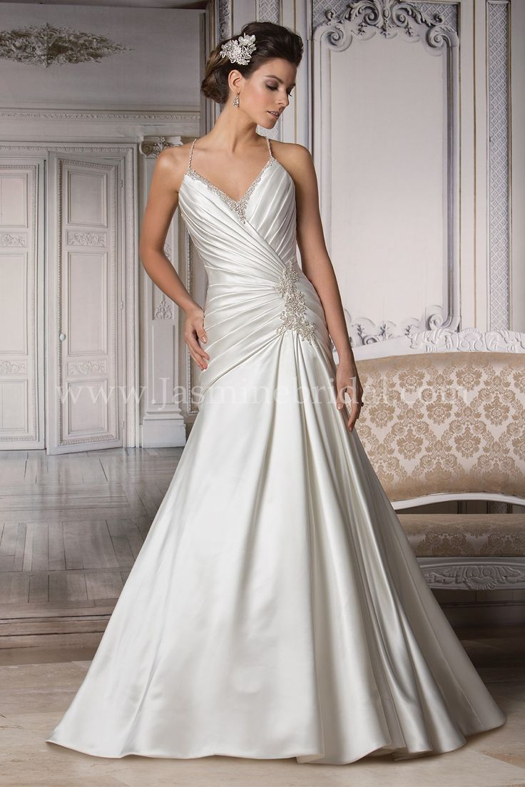 Spectacular Jasmine Bridal Couture Style in Ivory Silky Satin fabric wraps around this fit and flare wedding dress creating a ruched bodice