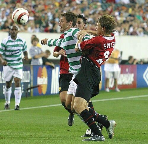 Celtic 2 Man Utd 1 in July 2004 in Philadelphia. Jonathan Spector challenges Chris Sutton in the friendly.