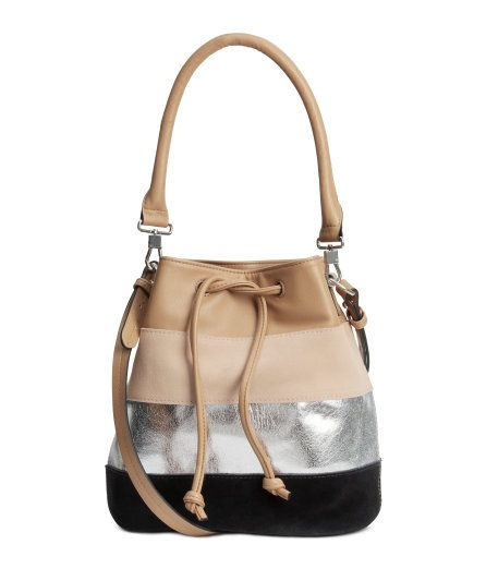 Check this out! Block-patterned bucket bag in imitation leather with black and light beige panels in genuine suede. Drawstring, shoulder strap, and short, detachable handle at top. Three inner compartments, one with zip. Lined. Size 5 1/2 x 8 x 10 in. - Visit hm.com to see more.