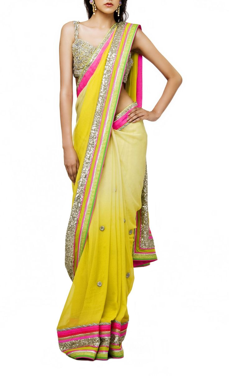 This #designersaree is of gorgette fabric having hand embroidered blouse. Color of this saree is double shaded yellow color. Saree itself have sequin work borders all over and hand work embroidery but