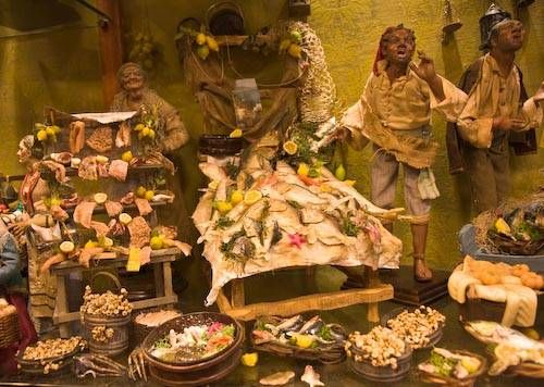 Scenes and Figures in a Presepe Shop  Naples Nativity Pictures  Representations of everyday life are common in Naples nativity scenes. These market figures are in the shop of Fulvio Forte on Via San Gregorio Armeno.