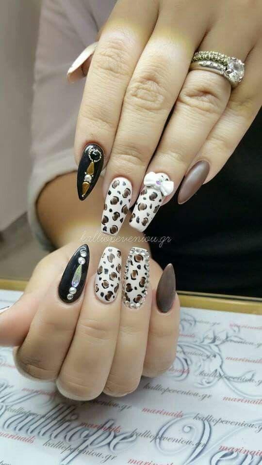 #nails #nailart #acrylicnails #animalprint #swarovskicrystals
