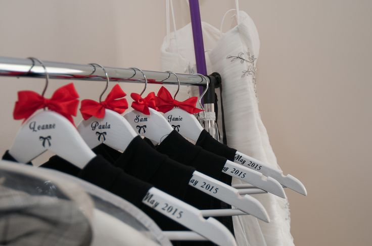 Cute personalised hangers for my bridesmaids. Red bow. Black dress
