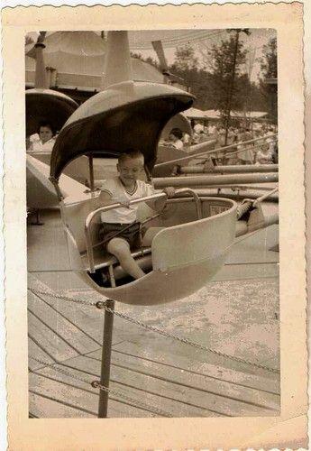 Vintage photograph little boy riding in an amusement park ride