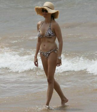 With her slim body and Dark brown hairtype without bra (cup size ) on the beach in bikini