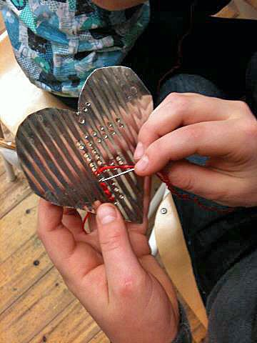 Easy ornaments cut out in tin punch an initial and thread through to make it stand out