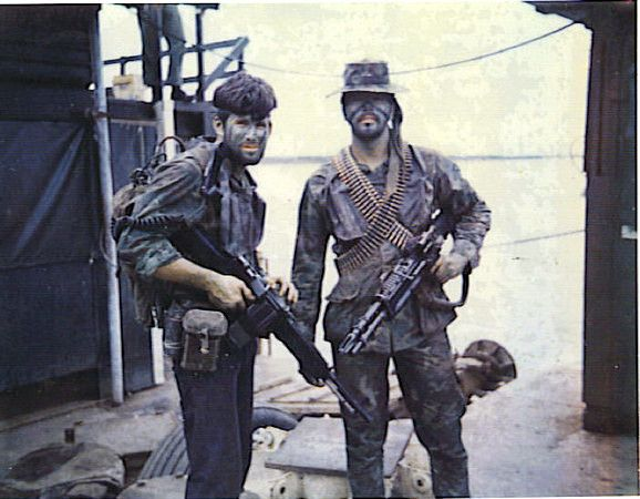 Two US Navy SEALs, date unknown. Can anyone identify the weapons? Thanks to the input of followers, the weapons have been identified, from left to right, as a Stoner 63, and an M60B.