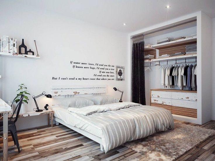 chambre blanche élégante aménagée avec un dressing penderie à rideau noir, table…