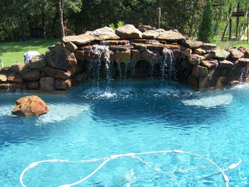 39 best images about stone waterfalls on pinterest for Swimming pool waterfalls construction