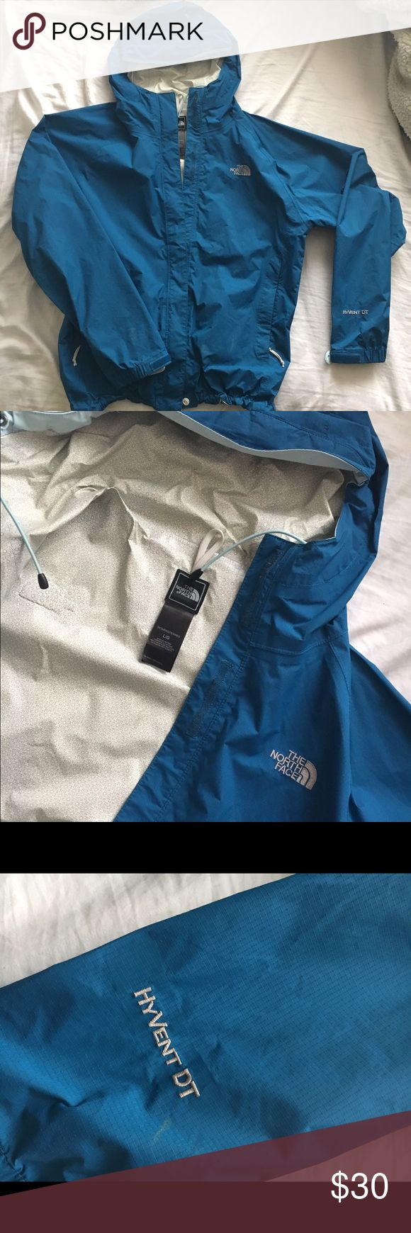 Northface blue water resistant jacket This jacket is in great condition,its only been worn a couple if times. It is water resistant and is perfect for wearing over sweatshirts. Willing to negotiate the price(: The North Face Jackets & Coats