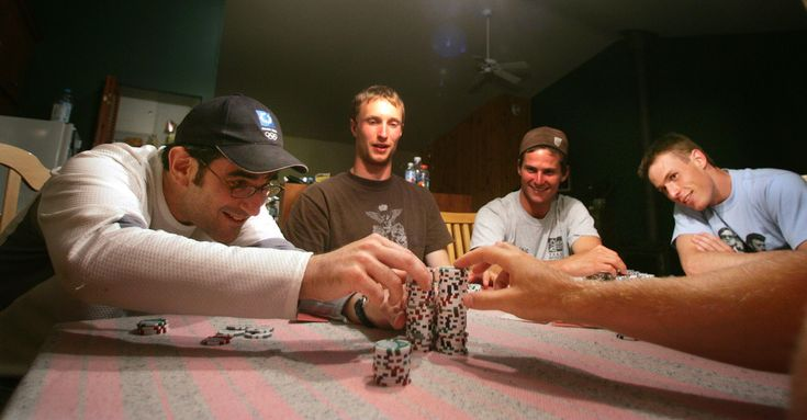Randy Starkman counts his stack after taking the Canadian mens Freestyle Aerial team in a game of Texas Hold'em poker after a day of practice at the Club de ski acrobatique Le Relais in Lac Beauport north of Quebec City.