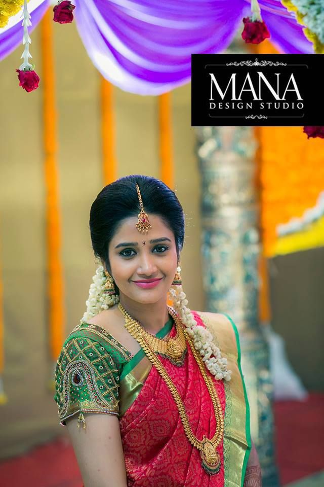 South Indian bride. Temple jewelry. Jhumkis.Red silk kanchipuram sari.Braid with fresh flowers. Tamil bride. Telugu bride. Kannada bride. Hindu bride. Malayalee bride.Kerala bride.South Indian wedding.