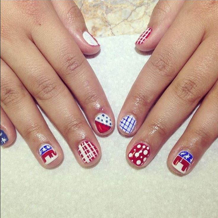 We love how intricate, but fun this manicure from Crystal Bubbles looks with its various polka dots and stripes. The fun designs and freehand elephants are the perfect way to show love for the Republican party.